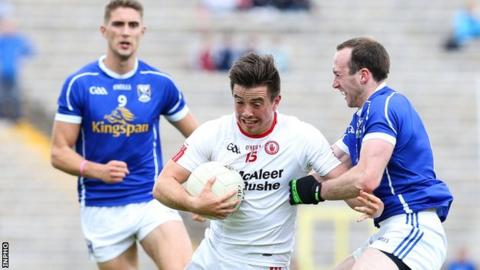 Tyrone forward Ronan O'Neill is tackled by Cavan's Fergal Flanagan in this year's Ulster SFC semi-final replay