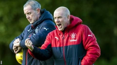 Rangers assistant David Weir and manager Mark Warburton at training