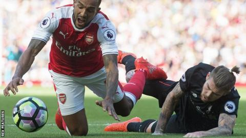 Alberto Moreno brings down Arsenal's Theo Walcott at the Emirates