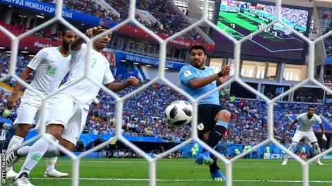 Luis Suarez scores for Uruguay