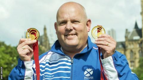 Alex Marshall shows off his two gold medals from Glasgow 2014