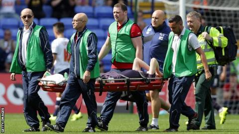 Will Hughes is taken off on a stretcher after being injured during Saturday's draw at Bolton