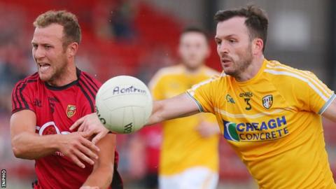 Down's Darren O'Hagan and Patrick Gallagher of Antrim in action at Pairc Esler