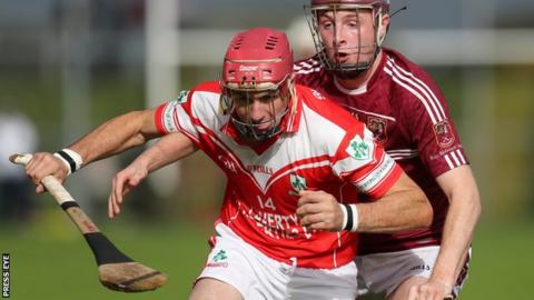 Liam Watson of Loughgiel in action against Cushendall's Eoghan Campbell