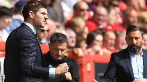 Steven Gerrard celebrates James Tavernier's penalty