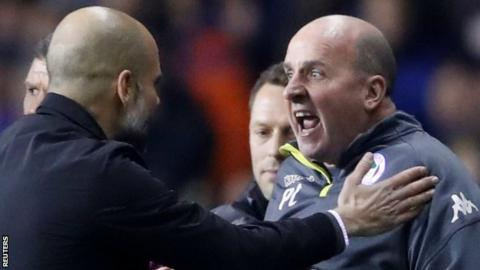 Wigan manager Paul Cook (right) argues with Pep Guardiola during Wigan's shock FA Cup fifth round win over Manchester City