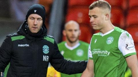 Ryan Porteous is forced off with injury during Hibernian's draw with Dundee United