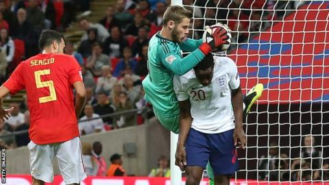 Danny Welbeck and David de Gea challenge for the ball in the incident that led to England's disallowed goal