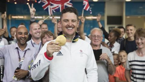 Justin Rose poses with his Olympic Gold Medal