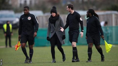 Match officials talk to Manchester United Women manager Casey Stoney after abandoning United's game at Charlton due to injury