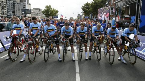 Alkmaar, Netherlands, 11 August: Belgian cyclists Jens Keukeleire, Yves Lampaert, Tim Merlier, Lawrence Naesen, Jasper Philipsen, Jonas Rickaert, Edward Theuns and Otto Vergaerde sit at the front of the peleton ahead of the European Road Championships for a minute's silence in tribute to Bjorg Lambrecht, of Belgium, who died following an accident during the Tour of Poland. (Photo by Bas Czerwinski/Getty Images)
