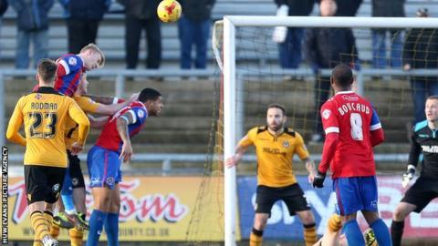 Joe Worrall scores Dagenham's second goal against Newport