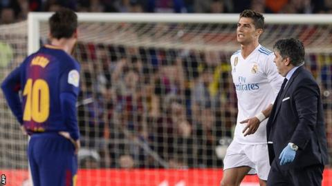 Real Madrid forward Cristiano Ronaldo reacts after suffering an injury against Barcelona
