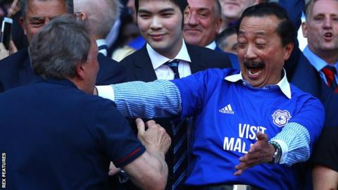Cardiff City owner Vincent Tan celebrates with manager Neil Warnock after the Bluebirds sealed promotion back to the Premier League.