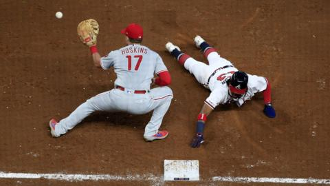 ATLANTA, GA - SEPTEMBER 18: Atlanta Braves Outfield Ronald Acuna Jr. (13) dives back into First base to avoid tag by Philadelphia Phillies First base Rhys Hoskins (17) during the MLB game between the Atlanta Braves and the Philadelphia Phillies on September 18, 2019 at SunTrust Park in Atlanta, GA.(Photo by Jeff Robinson/Icon Sportswire via Getty Images)