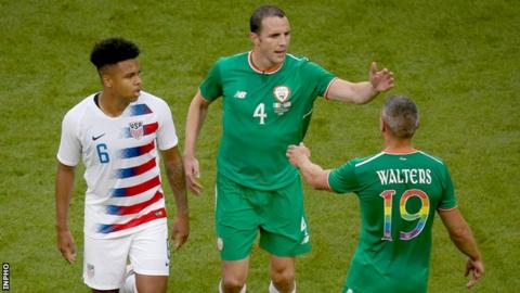 John O'Shea is congratulated by Republic of Ireland team-mate Jonathan Walters as he ended his international career after 118 caps