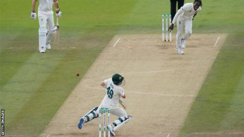 Steve Smith is struck on the neck by a Jofra Archer bouncer during the second Test at Lord's