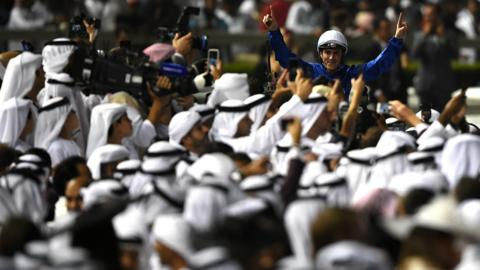 Christophe Soumillon riding Thunder Snow celebrates winning Dubai World Cup race during the Dubai World Cup Race Day at Meydan Racecourse on March 31, 2018 in Dubai, United Arab Emirates.
