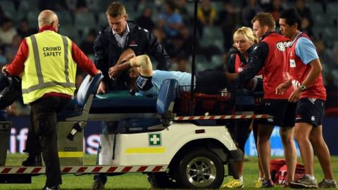 Kurtley Beale is taken off on a stretcher after being injured