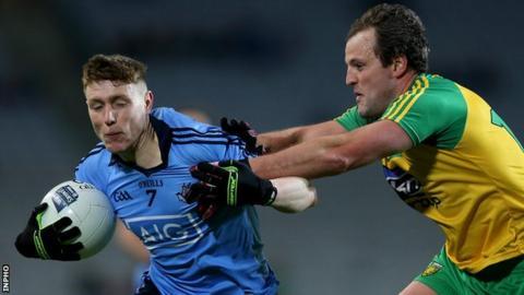 Michael Murphy battles with Dublin's John Small before his sending off