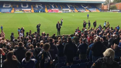 James Frith MP speaks to fans at Gigg Lane, Bury