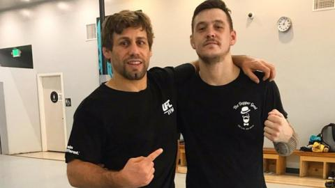Scott Malone, right, with UFC Hall of Fame fighter Urijah Faber in California