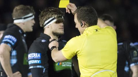 Glasgow Warriors' George Turner is shown a yellow card against Montpellier