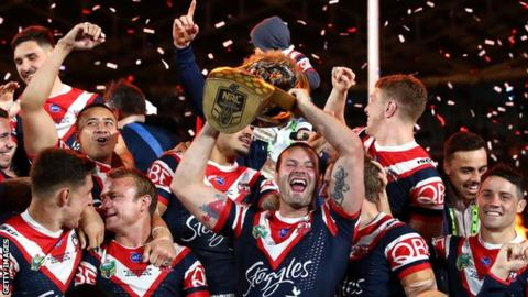 Sydney Roosters players celebrate their 2018 final