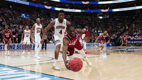 Clayton Henry #5 of the New Mexico State Aggies dives for the ball during the first half against the Auburn Tigers in the first round of the 2019 NCAA Men's Basketball Tournament at Vivint Smart Home Arena on March 21, 2019 in Salt Lake City, Utah. (Photo by Tom Pennington/Getty Images)