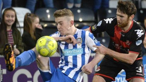 Coleraine's Jamie McGonigle is challenged by Howard Beverland in the the 1-0 win for Crusaders earlier this month
