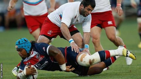 Joe Taufete'e of the United States is tackled by Russia's Nazir Gasanov at Bonney Field, Sacramento, California, June 2016