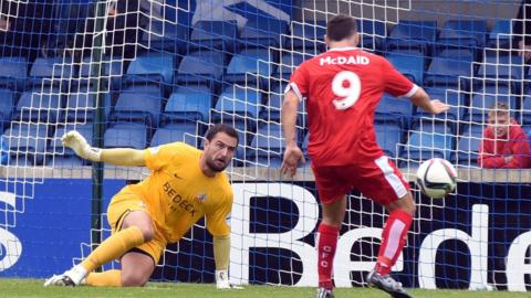 Reds striker David McDaid prepares to fire in the only goal to condemn Glenavon to an opening day defeat