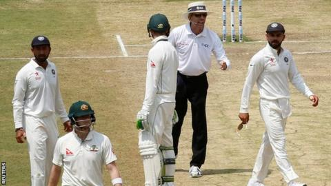 India captain Virat Kohli (right) looks at Australia counterpart Steve Smith as he walks off after being given out