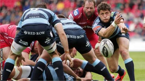 Lloyd Williams passes the ball from the base of a scrum while playing for Cardiff Blues