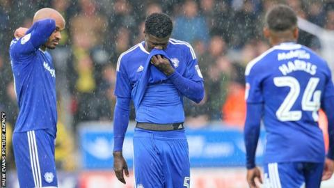 Cardiff City players are dejected following defeat at Burton