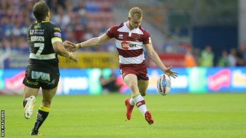 Wigan Warriors player Josh Woods kicks his match-winning drop-goal