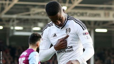 Ryan Sessegnon points to the Fulham badge as he celebrates his goal against Aston Villa