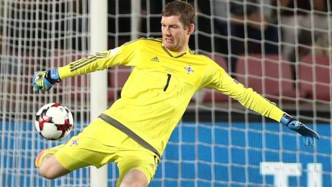 Northern Ireland goalkeeper Michael McGovern launches a kick upfield at the Generali Arena in Prague
