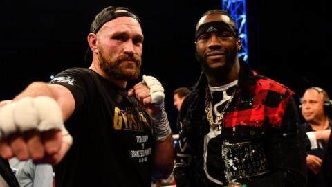Tyson Fury and Deontay Wilder in the ring in Belfast after Fury's fight with Francesco Pianeta