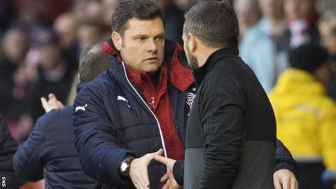 Rangers caretaker Graeme Murty shakes hands with Aberdeen's Derek McInnes at Pittodrie