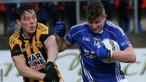Crossmaglen's Rico Kelly moves in to challenge Fergal McPhilips of Scotstown