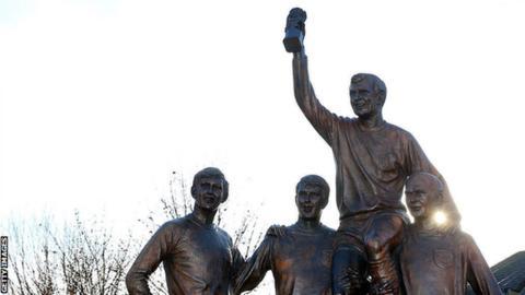 Statue of Ray Wilson. Sir Geoff Hurst, Bobby Moore and Martin Peters near the Boleyn Ground