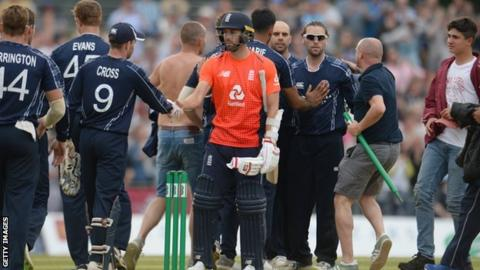 England's Mark Wood shakes hands with Scotland's players after their shock defeat by Scotland