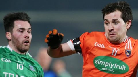 Fermanagh's Barry Mulrone in action against Fermanagh's Michael McKenna