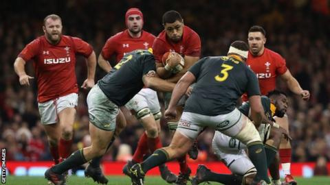 Taulupe Faletau of Wales is tackled by Malcolm Marx (L) and Wilco Louw during the rugby union international match between Wales and South Africa at the Principality Stadium on December 2, 2017