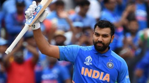 India opener Rohit Sharma raises his bat after hitting a century