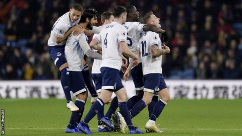 Everton players celebrate a goal against Burnley in December