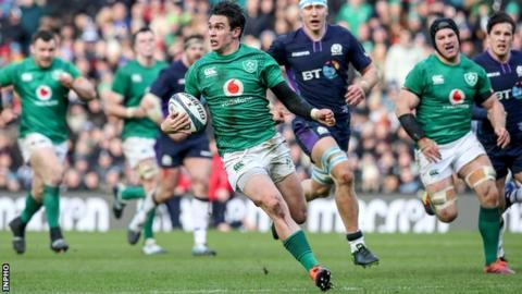 Joey Carbery makes a break in the lead up to Keith Earls try