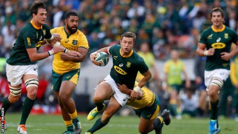 South Africa's fly-half Handre Pollard runs with the ball during the Rugby Championship match between South Africa and Australia