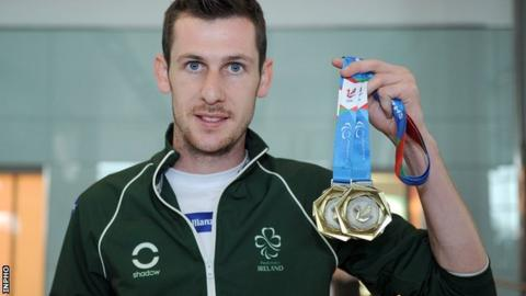 Michael McKillop shows off his two gold medals won at last summer's IPC European Championships in Swansea